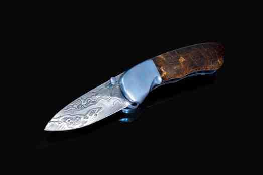 Textured titanium spalted maple and Damascus folder