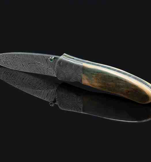 Green Toned Mammoth Ivory and Stainless Damascus Folding Knife