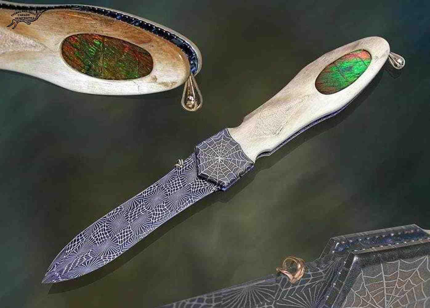 Ammonite dagger with invisible screw construction