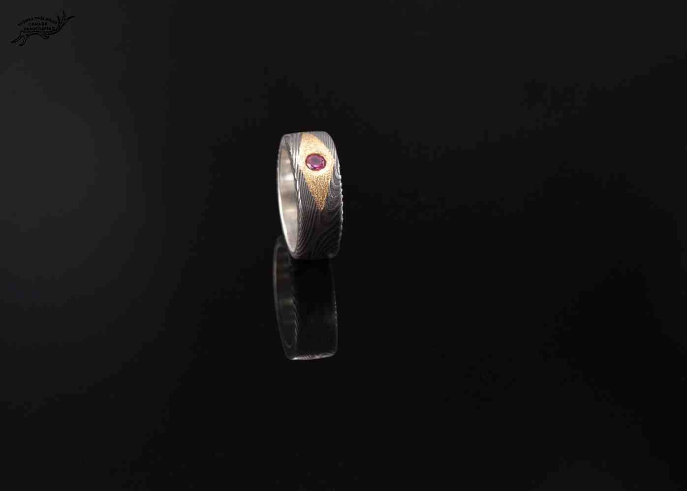 Forged Damascus ring with genuine ruby set in 24 carat yellow gold