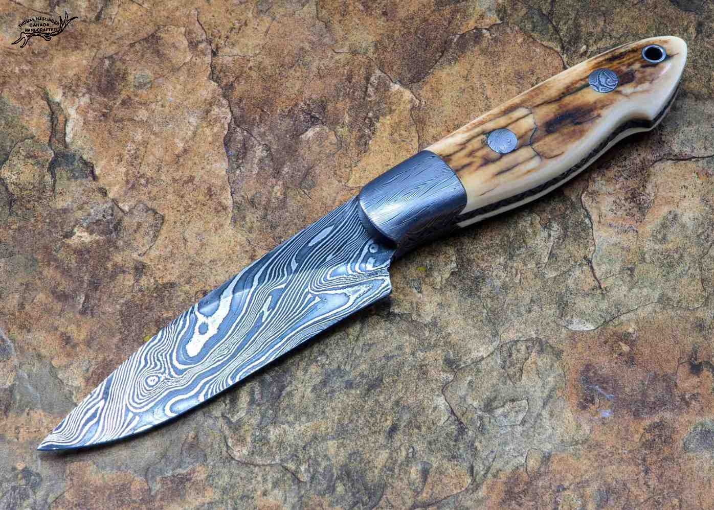Crowsnest Damascus and Ivory Hunter left view