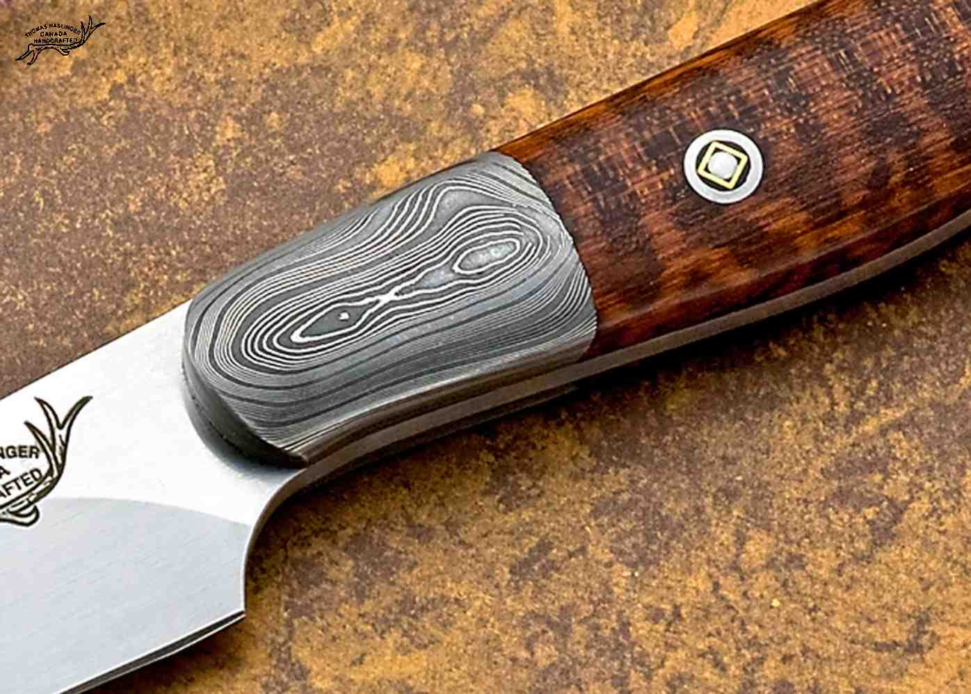 Snakewood Hunter with Damascus Bolsters close up
